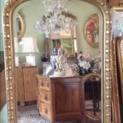 Grand miroir à fronton ovalisé